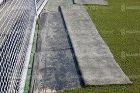 mats underneath fake grass